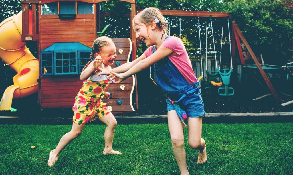two girls playing backyard