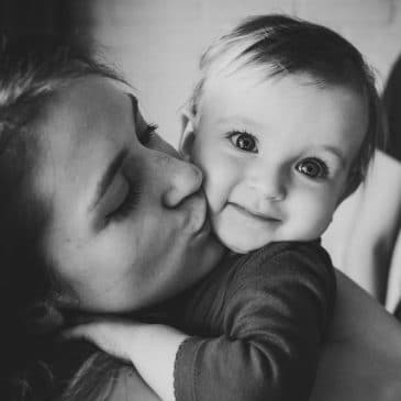 mother kiss daughter