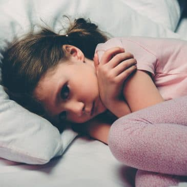anxious little girl in bed