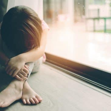 sad kid alone