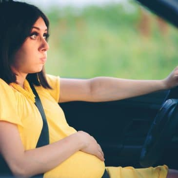 annoyed woman pregnant in a car