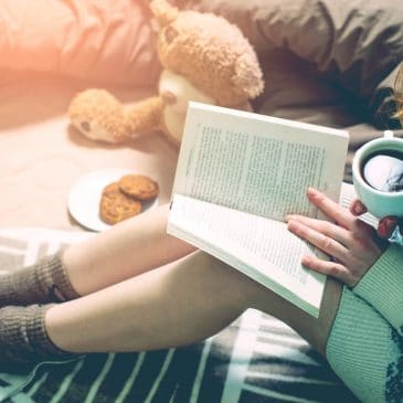 woman read book in bed