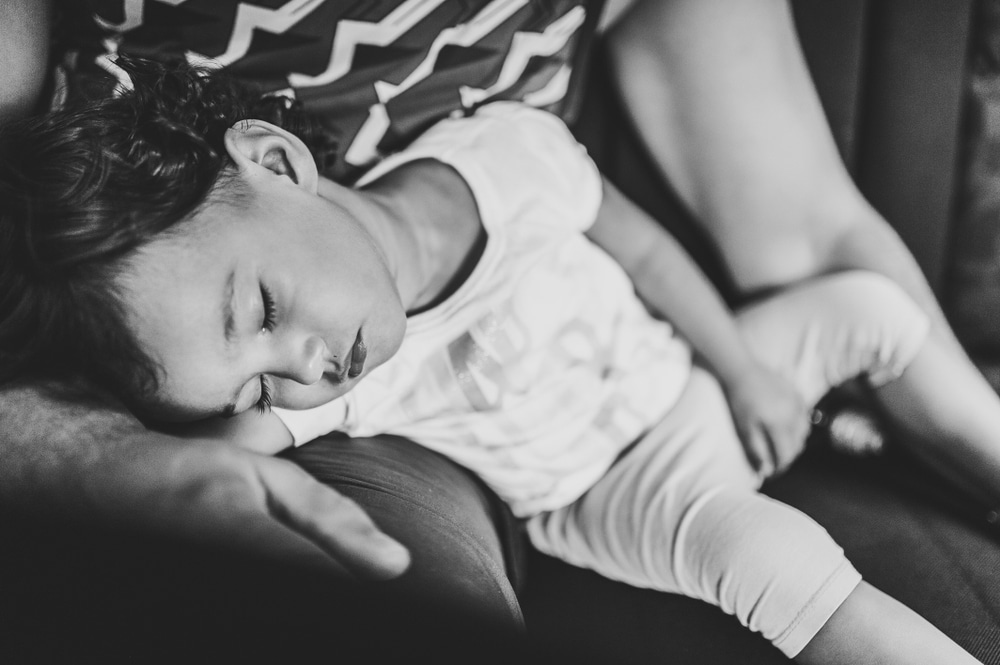 girl sleep in stepfather's arms