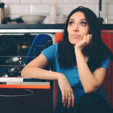 annoyed woman in kitchen