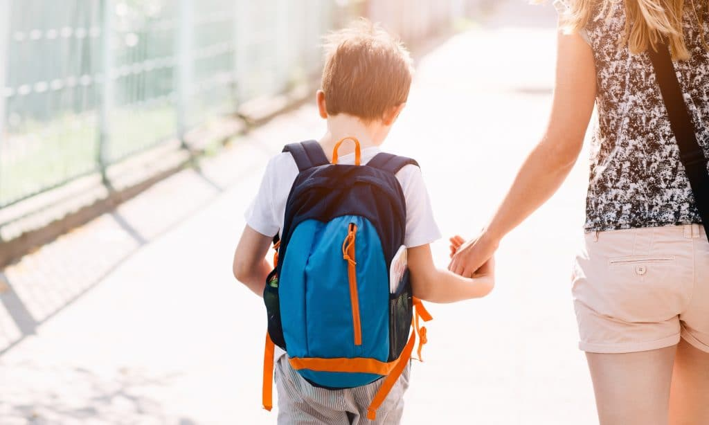 kid go to school with mother