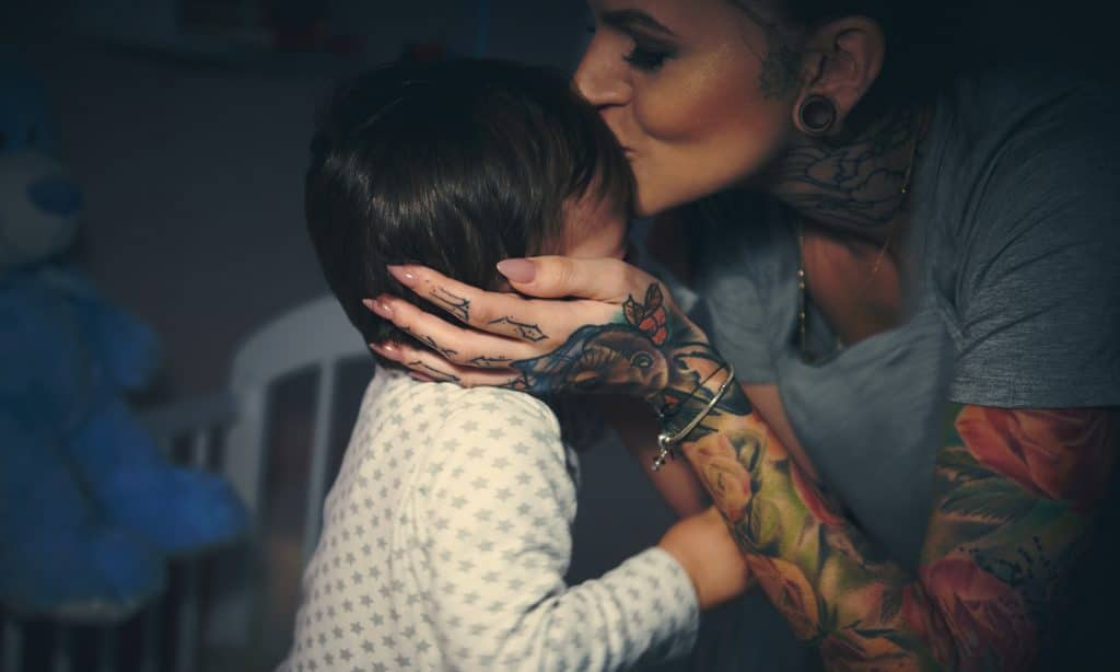 mother kiss little boy