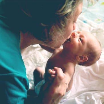 woman kiss baby