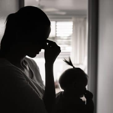 sad mother with baby