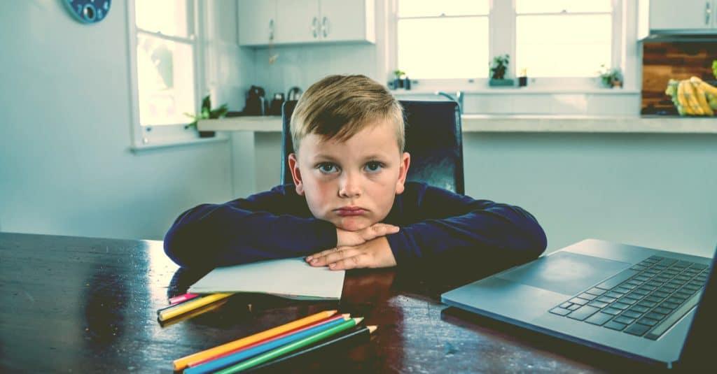 sad kid covid school online