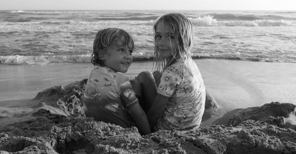 brother and sister on the beach
