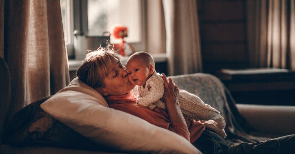 grandmother kiss baby
