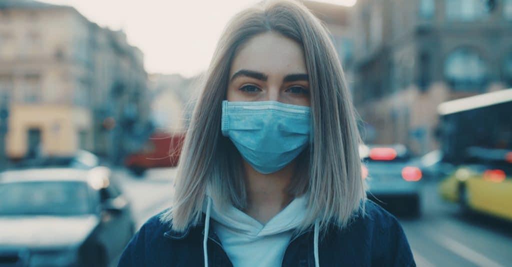 woman outside mask COVID-19