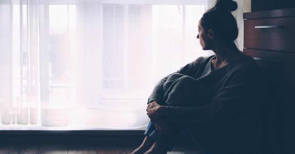 sad woman alone at home