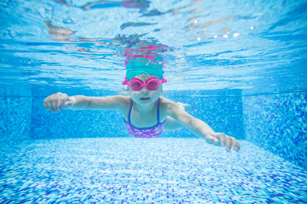 Little,Girl,Diving,In,Swimming,Pool