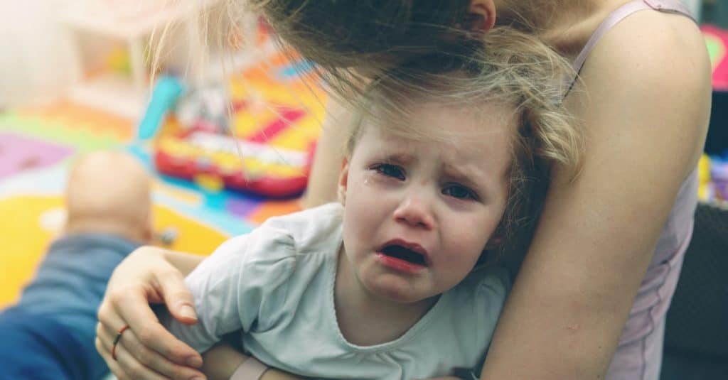 angry kid with mother