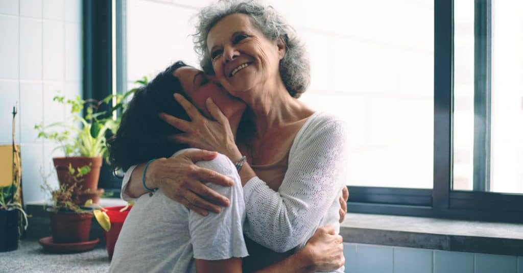 daughter hug senior mother