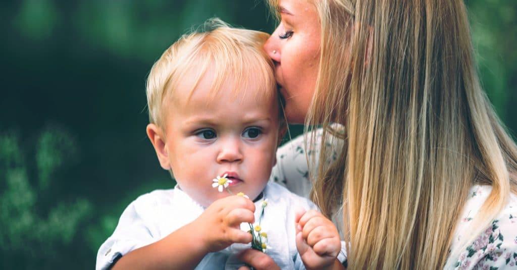 mother kiss little boy