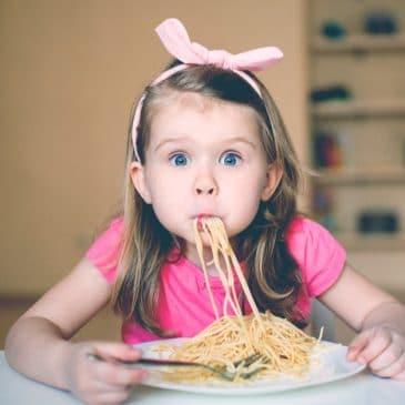 little girl eat spaghetti