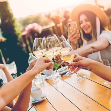 women drink wine