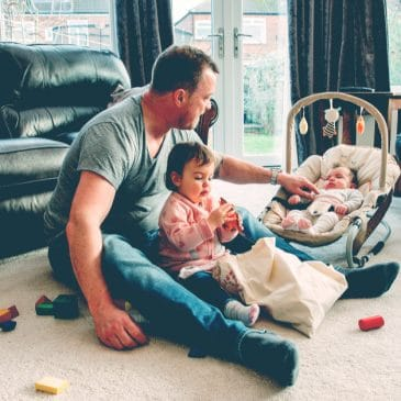 father with kid and baby