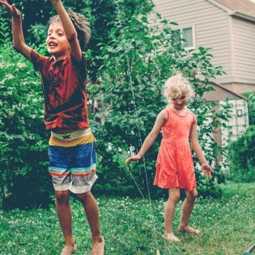 boy and girl outside home summer