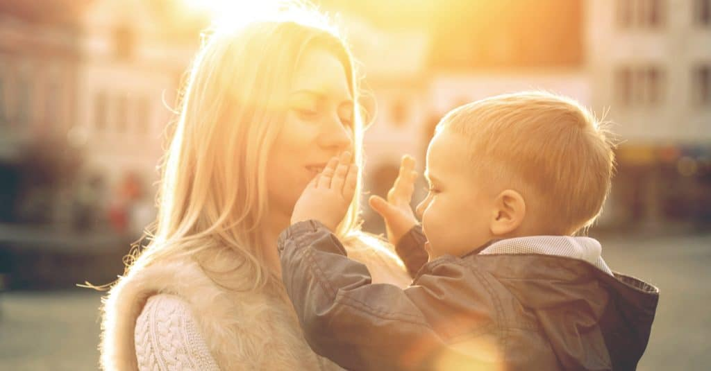 mother and little boy sun