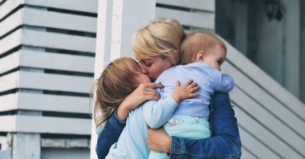 mother kiss kids goodbye