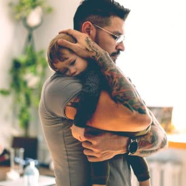 father hold little kid