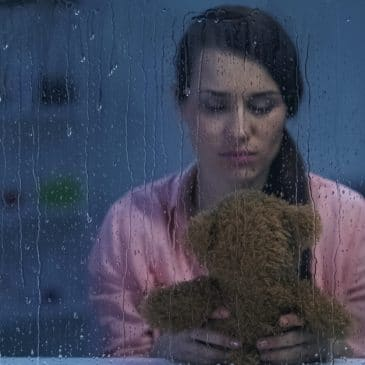 sad woman alone