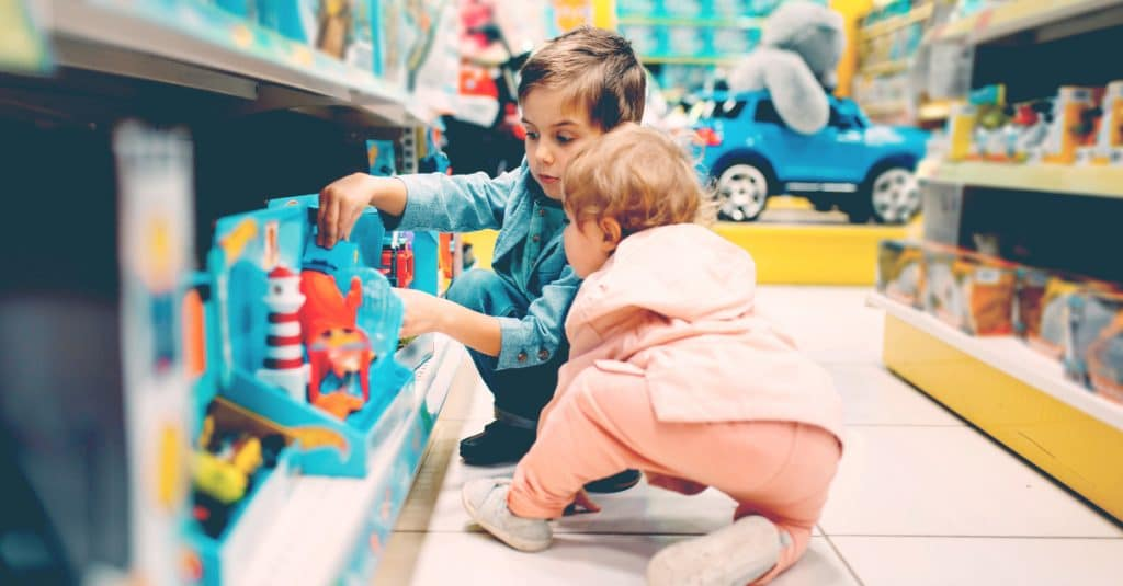 happy kids in toys store